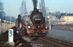 Zittau DR  |  1989 (keithwilde152) Tags: br99173176 9917311 zittau sachsen dr gdr east germany 1989 station town narrow gauge railway people loco crew buildings architecture automobiles passenger train steam locomotives outdoor spring sun