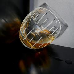 Oups, I spilled a little bit (Le.Patou) Tags: challenge lookingcloseonfriday glass fz1000 closeup reflect reflection dark liquid flash light black cristal burst square tilt