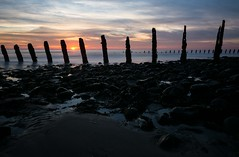 Groynes (Graham - bell) Tags: walney groynes seascape sea sunset sun sky stone sticks water cumbria nikon