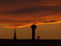 Orange in the sky (Elisabeth patchwork) Tags: sunset sky clouds roofs towers silhouettes