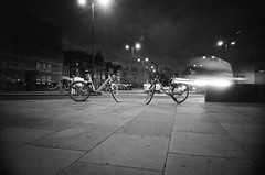 Frideswide Square, Oxford (Jim Davies) Tags: ricohr1 compactcamera 35mm 400asa veebotique film analogue filmfilmforever filmisnotdead filmisalive believeinfilm autumn outdoors analog picasa camera oxon september 2018 monochrome kodak bw400cn chromogenic c41 oxford october frideswidesquare night evening selftimer chance aleatoric mobikes bike bicycle cycling