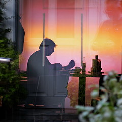 through the glass door (heinzkren) Tags: color farbe silhouette restaurant street streetphotography rainbow reflection reflektion spiegelung man human bar tabel door snack canon powershot vienna quadrado square candid pastell pastel urban people spiegelbild