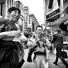 ginza, japan (michaelalvis) Tags: asia bw blackandwhite buildings candid citylife city cellphones pedestrian fujifilm flickr fujicolor friends ginza japan japon japanese japanesesigns monochrome mono nihon nippon peoplestreet portrait people peoplestreets photography streetphotography streetlife street signs sign travel tokyo urban women walking x70