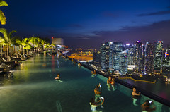 Marina Bay Sands Infinity Pool (Singapore) (My Wave Pics) Tags: vacation landmark marina water swimming skyscraper pool sky hotel asia city bay cityscape sands singapore luxury infinity travel tourism tourist skyline landscape people view rooftop building modern architecture summer top tower roof downtown beautiful relax business lifestyle high scene sunset asian girl structure destination urban