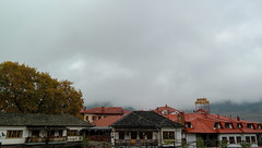 Clouds above Roofs (silve992) Tags: clouds sky fog grey roofs house village winter vacations metsovo mountain samsung nx300 trees