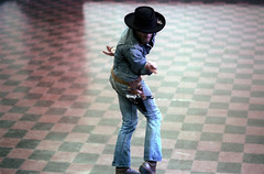74-294 (ndpa / s. lundeen, archivist) Tags: nick dewolf nickdewolf color photographbynickdewolf 1975 1970s film 35mm 74 reel74 autumn fall cambridge massachusetts dance rehearsal dancerehearsal people man youngman dancer dancing rehearsing hat cowboy holster pistol gun denim jeans jacket boots studio dancestudio