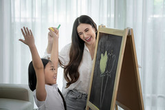 Asian teacher teach her student to draw a flower on ther blackboard (I love landscape) Tags: asia asian girl play paint talent image chalk artist color crayon draw pencil colur home family happy write lesson classroom creative blackboard drawing art education study room class school preschool flower fun portrait hand kid young little child mulatto preschooler board black learn mom mother teacher job woman lady thai