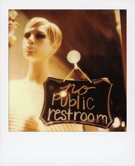 No Public Restroom (tobysx70) Tags: polaroid originals color sx70 instant film sx70sonar sonar no public restroom the palm tree boutique north elm street denton texas tx sign night nocturnal lit illuminated mannequin showroom dummy window display store shop polacon4 polacon2019 polacon 092919 toby hancock photography