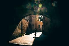 (Giovanni Piero Pellegrini) Tags: bike bicycle ravenna italy italia town day arch shadow travel tunnel light flare