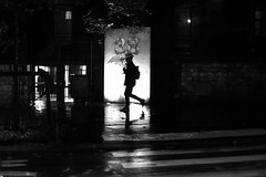 Under the translucent umbrella (pascalcolin1) Tags: paris13 homme man nuit night lumière light reflets reflection parapluie umbrella photoderue streetview urbanarte noiretblanc blackandwhite photopascalcolin 50mm canon50mm canon