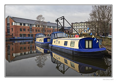 Reflections (Seven_Wishes) Tags: sheffield southyorkshire 2019 jo outdoor photoborder canoneos5dmarkiv canonef24105mmf4lisii sheffieldtinsleycanal narrowboats canalboats barge canal boats overcast reflections water buildings moored victoriaquays straddlewarehouse reflectionsinwater newcastleupontyne tyneandwear uk views10k