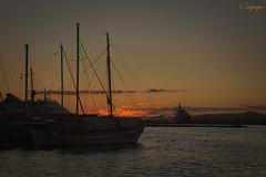 Desde el puerto... (cienfuegos84) Tags: atardecer velero barco sky cielo naranja