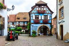 Vins D'Alsace Degustation - Wine tasting (George Plakides) Tags: vinsdalsace degustation winetasting cottage tractor france eguisheim flowers cobbledstreet