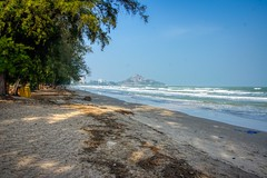 Suan Son beach with view of Khao Takiab near Hua Hin, Thailand (UweBKK (α 77 on )) Tags: huahin hua hin prachuapkhirikhan prachuap khiri khan thailand southeast asia sony alpha 550 dslr suanson suan son beach water ocean gulf tree khaotakiab khao takiab sea sky blue