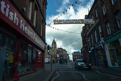 All and Bit Dark (Jocey K) Tags: tripukeroupe2019 june uk england sky clouds glenridding village signs flags clocktower street shops car road