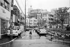 Morning (OzGFK) Tags: 35mm asia chm100 ei400 korea ricoh ricoh35zf southkorea analog blackandwhite bw film monochrome pushedfilm pushedtwostops streetphotography urban gwangju wet rain aftertherain