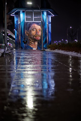 Painted Faces (Kurayba) Tags: edmonton alberta canada pentax k1 da 55 f14 rain freezing reflection painted faces public art portrait face lights downtown rogers place 105 ave avenue smcpda55mmf14sdm strength courage wisdom 6k raining