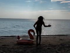 A Little Girl And Her Duck (hasneyhassan) Tags: thailand bangsaen lx100ii panasoniclumix naturallight sunset beach duck girl