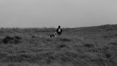 Freedom (patrick_milan) Tags: girl dog dune saint pabu finistere black white landscape smileonsaturday peopleandpets