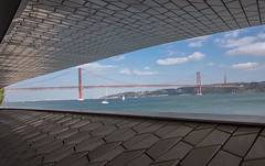 The 25 De Abril Bridge, Lisbon (Ray in Manila) Tags: maat museumofartarchitectureandtechnology belem christtheking tagusriverbridge salazarbridge americanbridgecompany tagusriver almada suspension 25deabril boat river bridge eos650d lisbon portugal