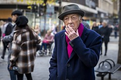 Smoking Jacket (Leanne Boulton) Tags: urban street candid portrait portraiture streetphotography candidstreetphotography candidportrait streetportrait eyecontact candideyecontact streetlife old man male face eyes expression mood emotion feeling style stylish fashion smoke smoker smoking cigarette hat pink blue tone texture detail depthoffield bokeh naturallight outdoor light shade city scene human life living humanity society culture lifestyle people canon canon5dmkiii 70mm ef2470mmf28liiusm black white blackwhite bw mono blackandwhite monochrome glasgow scotland uk