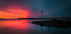 The Dark Destroyer (RonnieLMills 7 Million Views. Thank You All :)) Tags: sunrise dawn early morning colours red sky donaghadee harbour lighthouse long exposure water blur rocks marker sea magenta county down northern ireland ronnielmills landscape photography thedarkdestroyer