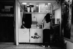 Momas Bubble Tea Bar and psychic's door (ronn.aldaman) Tags: leicam5 leica50mmsummicronmcollapsible kodaktrix film analogue bw bangkokcityofangelsandangles augustseptember2019 street people southeastasia