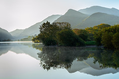 Hazy Sunrise - Llanberis (Anthony White) Tags: caernarfon wales unitedkingdom dolbadarncastle wacomintuospro wacomtablet still lake northwales haze mist sunlight nopeople dynamiclight