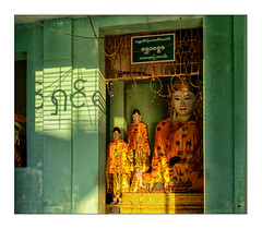 shadow writing between the Buddhas (Armin Fuchs) Tags: arminfuchs yangon rangoon myanmar burma shwedagonpagoda buddha buddhism buddhismus light shadow gold green enlightenment 6x7