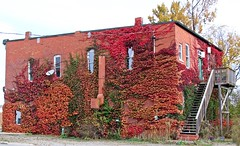 Long Gone - Talbot Trail: Morpeth, Ontario (Daryll90ca) Tags: red building apartment store morpeth morpethontario ontario canada ontariocanada talbottrail