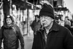 Pipe Dreams (Leanne Boulton) Tags: urban street candid portrait portraiture streetphotography candidstreetphotography candidportrait streetportrait streetlife old elderly man male face eyes expression mood emotion feeling hat beanie cold winter smoke smoker smoking pipe tobacco tone texture detail depthoffield bokeh naturallight outdoor light shade city scene human life living humanity society culture lifestyle people canon canon5dmkiii 70mm ef2470mmf28liiusm black white blackwhite bw mono blackandwhite monochrome glasgow scotland uk