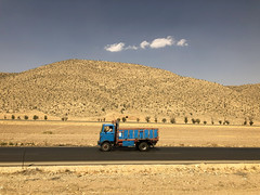 Iran, Shiraz - Truck on the road from Yazd - October 2019 (Cyprien Hauser) Tags: truck iran lorry shiraz yazd road asphalt mountain transport vehicle persian sky cloud motor