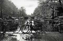 Bicycles and canals (peer.heesterbeek) Tags: bicycles canals water street blackwhite monochrome amsterdam netherlands sun shadow light