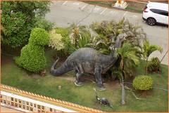 Khon Kaen, Dinosaurs 20190522_102109 DSCN6321 (CanadaGood) Tags: asia seasia asean thailand thai ราชอาณาจักรไทย isaan khonkaen dinosaur statue topiary temple tree garden canadagood 2019 color colour concrete parking decade2010