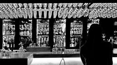 single in the vine bar (heinzkren) Tags: schwarzweis blackandwhite bw sw biancoetnero noiretblanc candid vienna bar wein vine bottles flaschen gläser woman human glasses urban city local pub drink canon eosr monochrome silhouette