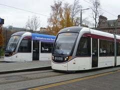 Edinburgh trams cross at St. Andrew Square tramstop. (calderwoodroy) Tags: edinburghtransport transportforedinburgh edinburghtrams 251 262 urbos100 caf standrewsquaretramstop tram tramstop tramway saintandrewsquare edinburgh scotland