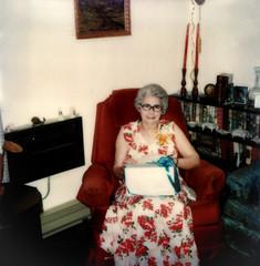 Grandma Opening Present 1976 (Bracus Triticum) Tags: people canada chair manitoba gift present 1976 summer sitting alberta カナダ アルバータ州