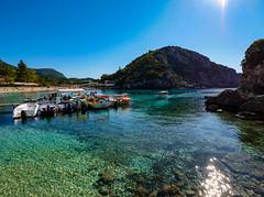 Paleokastritsa Beach in Corfu , Greece (Seymour Lu) Tags: clear waters crystal beach coastal tourism amazing places ocean mediterranean boats blue aqua sea caves paleokastritsa corfu greece europe lumix panasonic gh5 leica angle wide slr travel sun