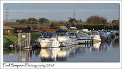 Torksey Lock (Paul Simpson Photography) Tags: fossdykecanal lincolnshire water river canal boats boat yacht yachts torksey torkseylock waterway transport november2019 paulsimpsonphotography powerlines coupleoutforawalk countryside eastmidlands westlindsey transportnetwork canalboats canalboat waterreflection reflections fossdyke leisure leisuretime england uk lincs