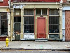Living Behind Bars (J Wells S) Tags: door windows storefront bars streetscene urban urbandecay overtherhine otr findlaymarket cincinnati ohio