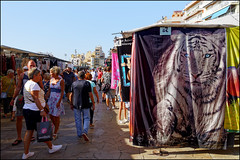 Monday Market   Blanes, Catalonia (Flemming J. Gade) Tags: market clothes towels tiger blanes catalonia people