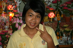 in front of an elaborate home shrine (the foreign photographer - ฝรั่งถ่) Tags: girl yellow shirt khlong thanon portraits bangkhen bangkok thailand canon