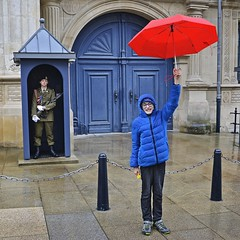 shelter (t.horak) Tags: two people man boy soldier guard uniform umbrella red shelter blue gate luxembourg square gun