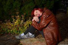 A Mood (Fly Sandman) Tags: model modelshoot redhead woman girl inajaneburns coat evergreen cold blueeyes autumn fall rock oppdarboretum omaha nebraska sony alpha a99 flash offcameraflash godox ad600 affinityphoto photoshop elements moody