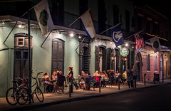 Orleans Grapevine Wine Bar & Bistro (donnieking1811) Tags: louisiana neworleans orleansgrapevinewinebarbistro building exterior outdoors night people flags tables lights signs canon 60d lightroom