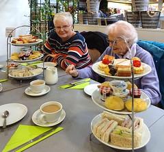 Conversation in a café (Snapshooter46) Tags: women conversation café afternoontea cakes sandwiches cakestand