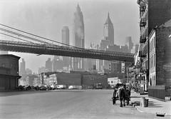 City on the Make: Looking down South Street in New York City. November 1933. (polkbritton) Tags: newyorkhistory newyorkcity streetphotography gottschoschleisner libraryofcongresscollections empirestatebuilding brooklnbridge 1930s