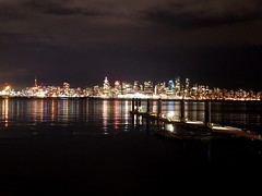 The city at night (walneylad) Tags: vancouver britishcolumbia canada burrardinlet november fall autumn night dark evening city lights cbd downtown skyline urbanscape harbour waterfront sea ocean water waves reflections buildings sky clouds pier wharf lonsdalequay