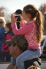 Recording from her perch (radargeek) Tags: claremore ok oklahoma children kid shoulderride child kids cellphone ponytail 2019 november