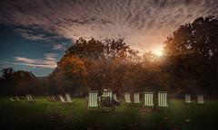 recharge (Chrisnaton) Tags: park autumn nature relax eveningmood eveningcolors eveningsky sunset deckchairs stjamespark london